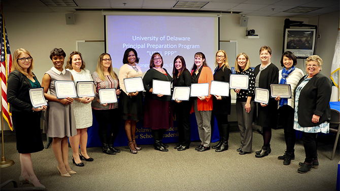Graduates from the first cohort of the Principal Preparation Program with Delaware Academy for School Leadership (DASL) Director Jackie Wilson.